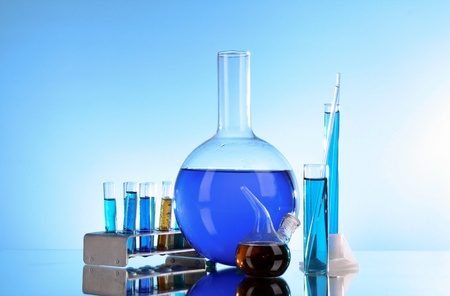 Test tubes on blue background photo