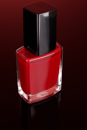 nail polishes on red background photo