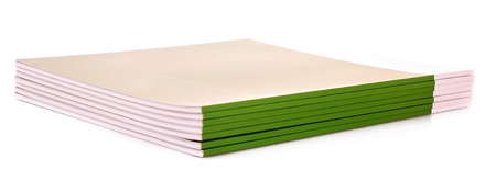 Pile of green journals isolated on white photo