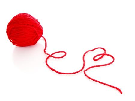 wool fiber: Bola roja de lana hilo rojo aislado en blanco Foto de archivo