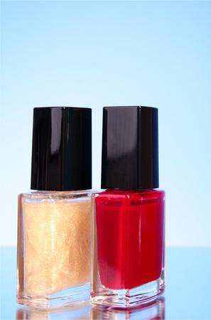 nail polishes on blue background photo