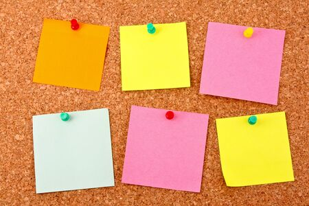 Six colorful stickers pinned to a cork board Stock Photo - 8762656
