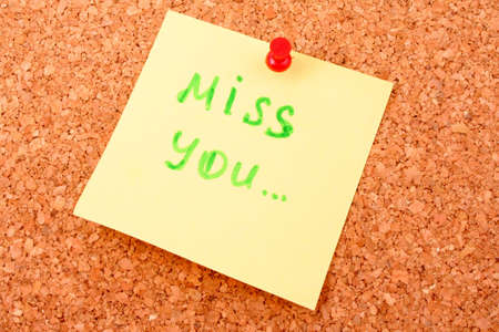miss you: Sticker on cork board with text Stock Photo