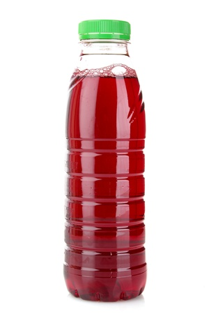 Bottle with juice isolated on white photo