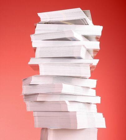 stack of paper: a stack of business cards on a red background