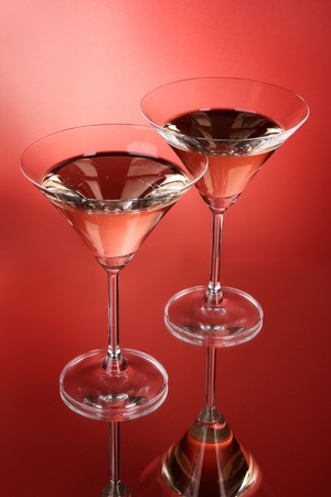Two martini glasses on red background Stock Photo - 8914572