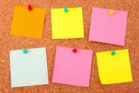 Six colorful stickers pinned to a cork board Stock Photo - 8915118