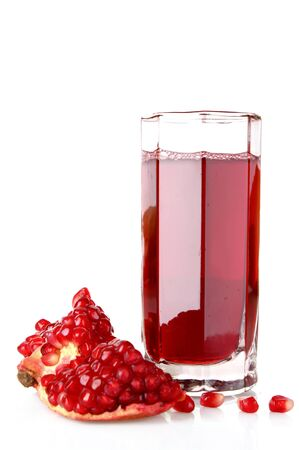 pomergranate: Sliced pomergranate and glass of juice isolated on white