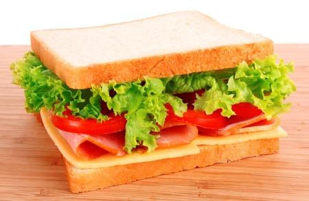 Sandwich on wooden plate