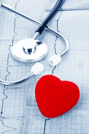 ekg: Stethoscope on ECG and red heart