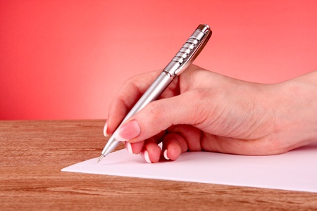pen in hand writing on paper Stock Photo - 9005422