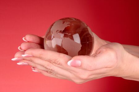 Crystal ball on hand. Red background Stock Photo - 9005407