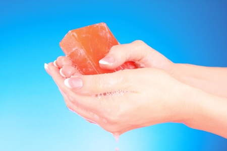 sudsy: Hands with soap on blue background