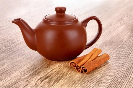 'cinnamon bark': Cinnamon bark and teapot on wooden table Stock Photo