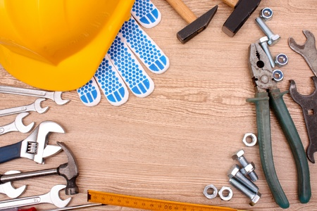Tools on wooden surface photo