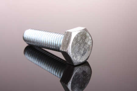 Screw with reflection on grey background photo