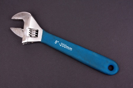 screwdriwer: adjustable wrench on gray background