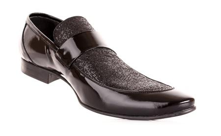 Black shiny mans shoe isolated on white photo