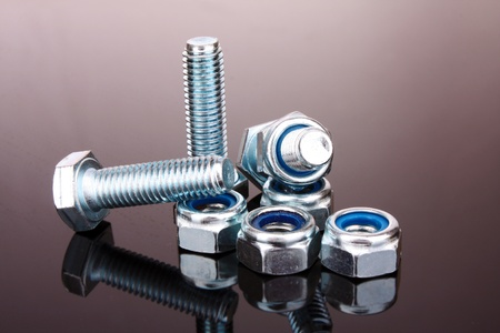 Screw and bolt with reflection on grey background Stock Photo - 9150279