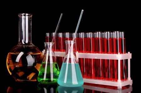 Laboratory glassware on black background photo