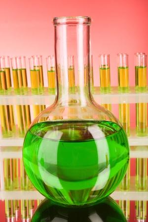 Flask on test-tubes background photo