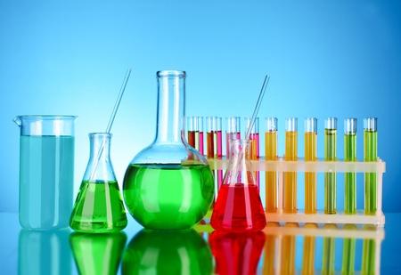 scientifical: Laboratory glassware on blue background Stock Photo