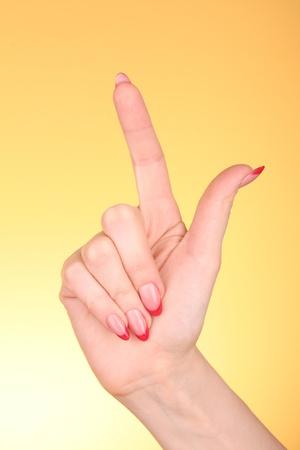 Hand on yellow background photo