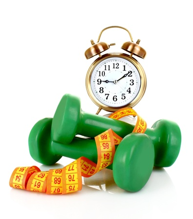 Old alarm-clock, dumbbells and measure tape photo