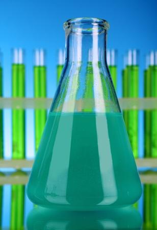 Laboratory glassware on blue background Stock Photo