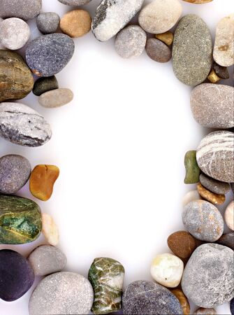 Frame made from Round pebble stones isolated on white photo
