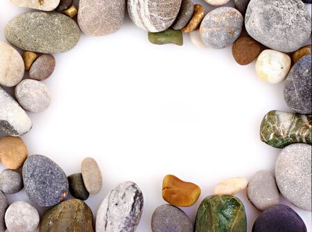 Frame made from Round pebble stones isolated on white Stock Photo - 9281637
