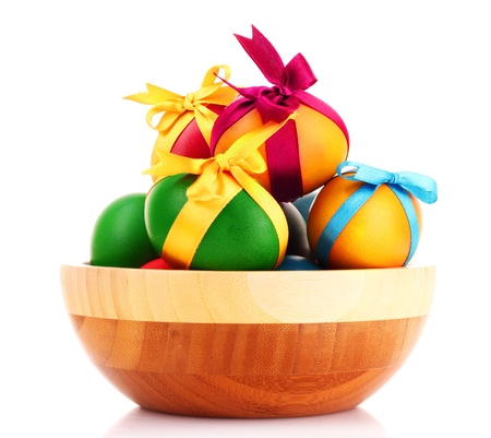 Easter eggs in wooden bowl isolated on white Stock Photo - 9281628