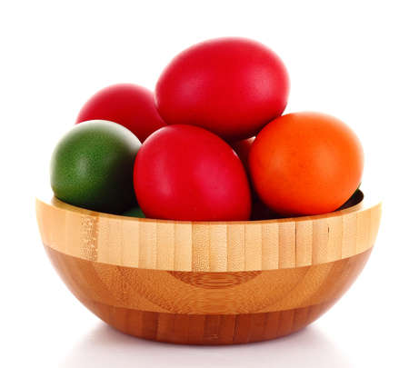 Easter eggs in wooden bowl isolated on white Stock Photo - 9281621