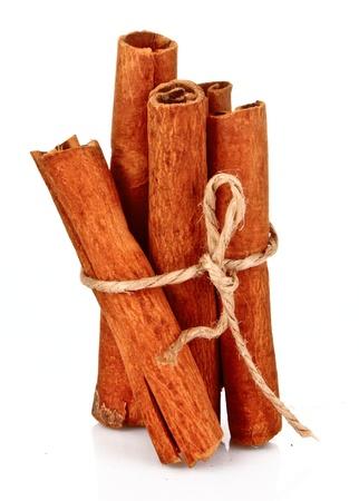 cinnamon: Cinnamon bark isolated on white