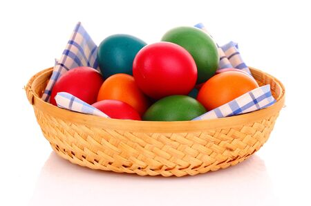 Easter eggs in backet isolated on white photo