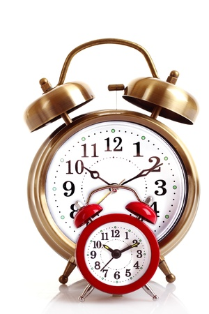 Old alarm-clock on blue background Stock Photo - 9322370