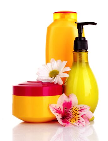 Flower and liquid soap isolated on white photo