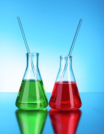 Laboratory glassware on blue background photo