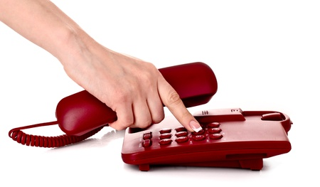 phone operator: Dialing on the red phone Stock Photo