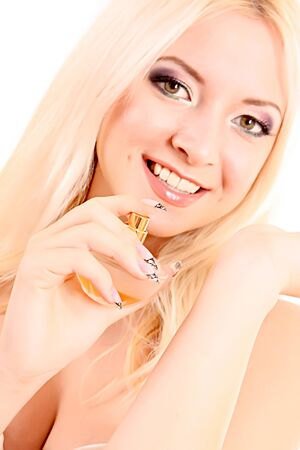 woman with bottle of perfume in the hand isolated on white photo