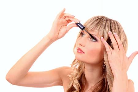 Beautiful young blonde woman applying mascara on her eyelashes Stock Photo - 9784462