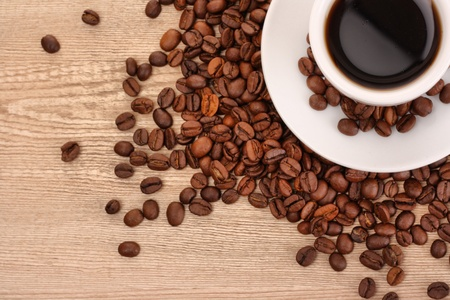 coffee with cinnamon on wooden texture background photo