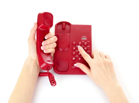 phone service: Dialing on the red phone Stock Photo