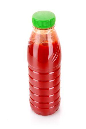 Bottle with juice isolated on white photo