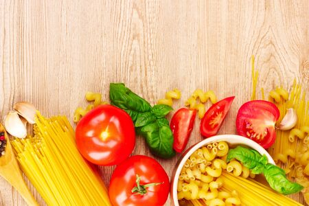 spaghetti with garlic, onion, spices  and basil on a yellow background Stock Photo - 9384691