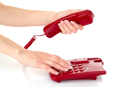 Dialing on the red phone Stock Photo - 9489227