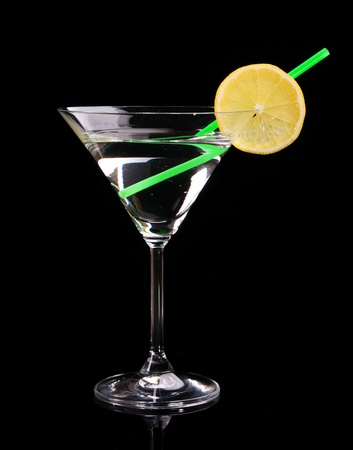 hard liquor: Martini glass on black background