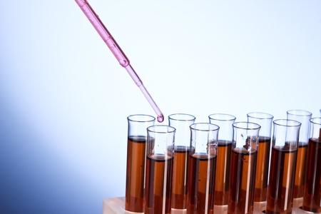 Test tubes closeup on blue background photo