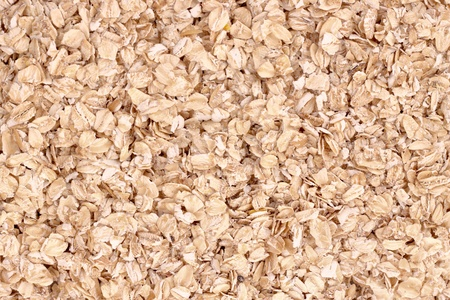 Uncoocked rolled oats as texture photo