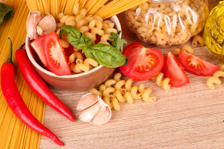 spaghetti with garlic, onion, spices  and basil on a yellow background Stock Photo - 9516864